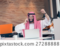Arabian businessman working in modern startup 27288888