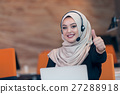 Beautiful phone operator arab woman working in 27288918