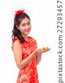 Chinese woman holding gold ingots  27293457