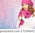 close up of woman in hat and scarf over lights 27294842