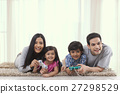 Family playing game with game console in living room 27298529