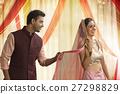 Beautiful young couple in traditional dress dancing 27298829