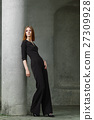 Red hair fashion model in black overall posing 27309928