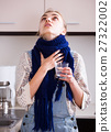 woman in scarf gargling throat with domestic soda 27322002