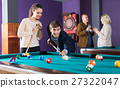 People playing billiard 27322047