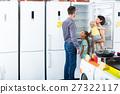 family choosing new fridge 27322117