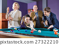 Group of cheerful pretty positive friends playing billiards 27322210
