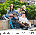 Company of carefree teenagers musicians 27322893