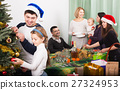 Big family celebrating Xmas 27324953