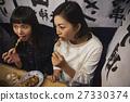 Nakushu stalls Women enjoying food 27330374
