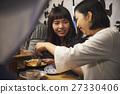 Nakushu stalls Women enjoying food 27330406