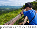 Asian boy relaxing outdoors, travel on vacation 27334346
