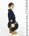 Little Boy Standing Holding Record Concept 27348504