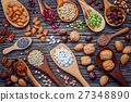 Various legumes and different kinds of nutshell. 27348890