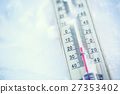 Thermometer on snow shows low temperatures. 27353402