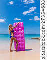 Slim blonde woman with air mattress tropic beach 27354603