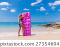 Slim blonde woman with air mattress tropic beach 27354604