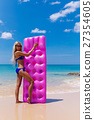 Slim blonde woman with air mattress tropic beach 27354605