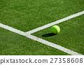 tennis ball on tennis grass court 27358608