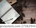 Pen and recycle notebook on wood background 27362944