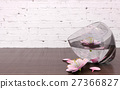 Pink flower blossoms in glass vase  27366827