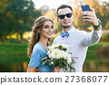 Beautiful young couple on wedding ceremony 27368077