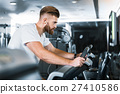 Concentrated sporty man in gymnasium 27410586