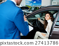 Beautiful young woman buys a car in the dealership 27413786