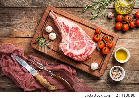 Raw tomahawk beef steak 27413999