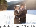 Beautiful senior couple on a walk on sunny winter 27420339