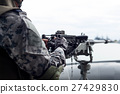 Selected focus Navy soldier hand on machine gun on 27429830