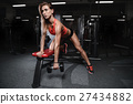 Athletic young woman posing and exercising fitness 27434882