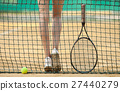 Clay tennis court with tennis player legs,ball 27440279