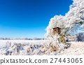 Wooden brown hunting shelter next to frozen trees 27443065