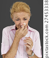 Senior Women Blowing Nose Concept 27453338