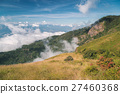 Green mountain with floating cloud and blue sky 27460368