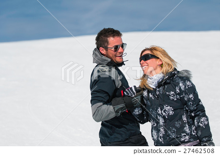 Ski couple holding hands 27462508