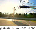A young basketball player flying towards the rim 27463264