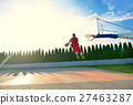 A young basketball player flying towards the rim 27463287