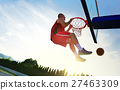 Young basketball player drives to the hoop for a 27463309
