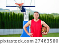 Basketball player with ball at the outdoors basket 27463580