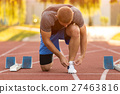 Male athlete tying laces for jogging. 27463816