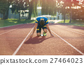 Track runner in starting position on sunny morning 27464023