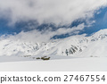 High mountains under snow with clear blue sky 27467554