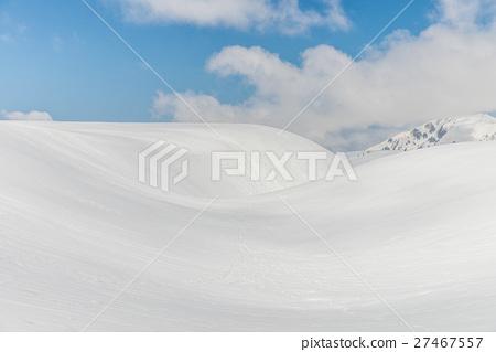 Snow hills against clear blue sky 27467557
