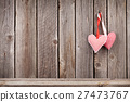 Two Valentines day hearts on rustic wooden wall 27473767