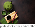 Green teapot and tea cups 27473787