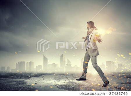 Businessman throwing petrol bomb 27481746