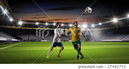 Soccer players fighting for ball 27482753