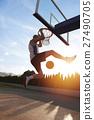 Young man jumping and making a fantastic slam dunk 27490705